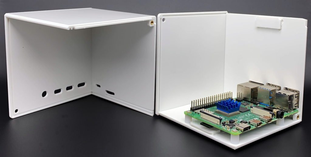 CamdenBoss Cube Raspberry Pi 4 Case - Two pieces side by side with Pi inside